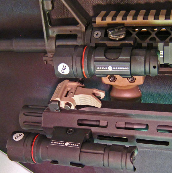 Crimson Trace Provides A Couple Of Lighting Solutions For Longish Guns The CWL 100 Top Is Single Cell 201 2 900 Lumens Light